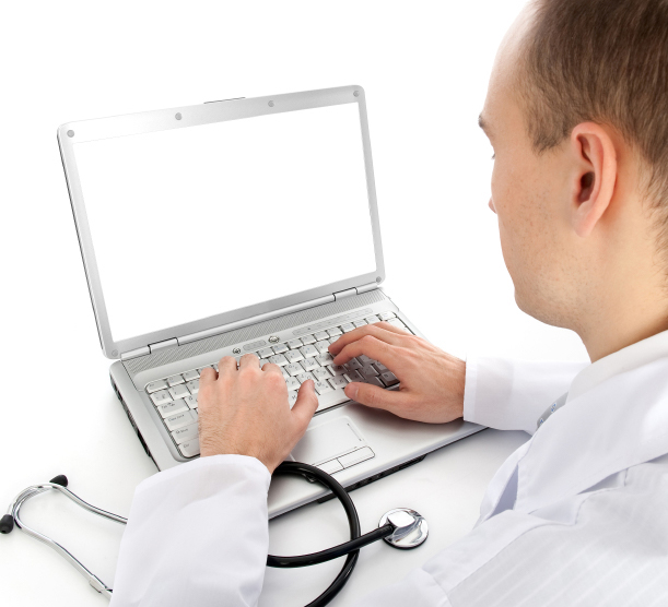 Healthcare professional completing a writable PDF form on his computer